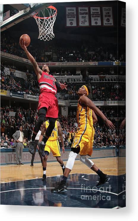 Nba Pro Basketball Canvas Print featuring the photograph Damian Lillard by Ron Hoskins