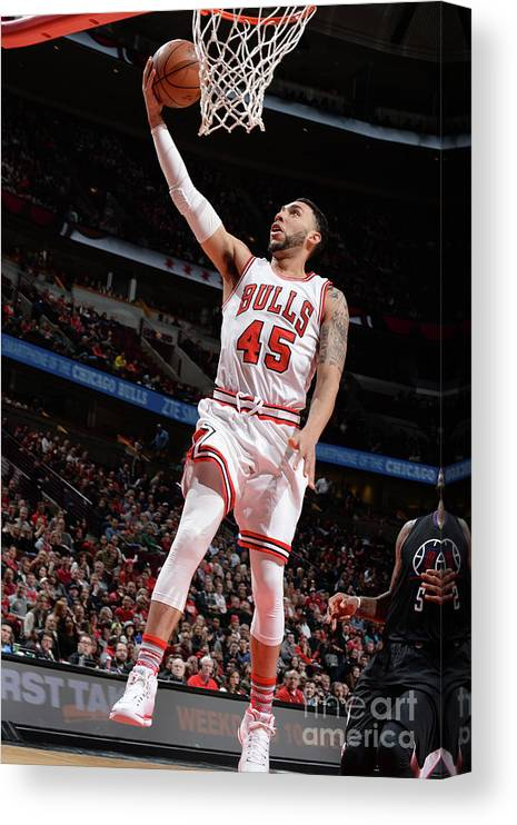 Nba Pro Basketball Canvas Print featuring the photograph Denzel Valentine by Randy Belice