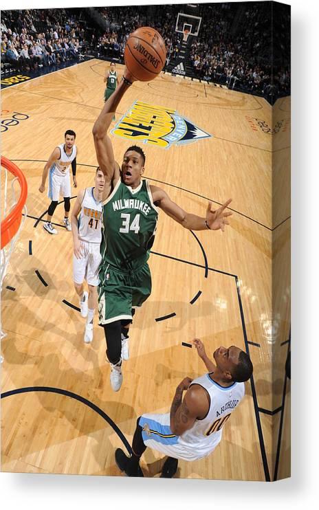 Nba Pro Basketball Canvas Print featuring the photograph Giannis Antetokounmpo by Garrett Ellwood