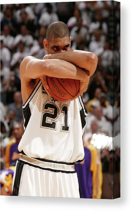 Nba Pro Basketball Canvas Print featuring the photograph Tim Duncan by Garrett Ellwood