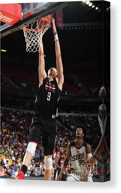 Nba Pro Basketball Canvas Print featuring the photograph Zhou Qi by Garrett Ellwood