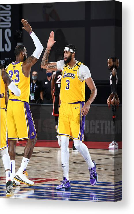 Playoffs Canvas Print featuring the photograph Anthony Davis and Lebron James by Andrew D. Bernstein