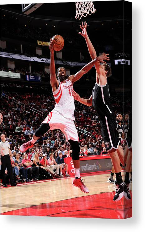 Nba Pro Basketball Canvas Print featuring the photograph Nene Hilario by Bill Baptist