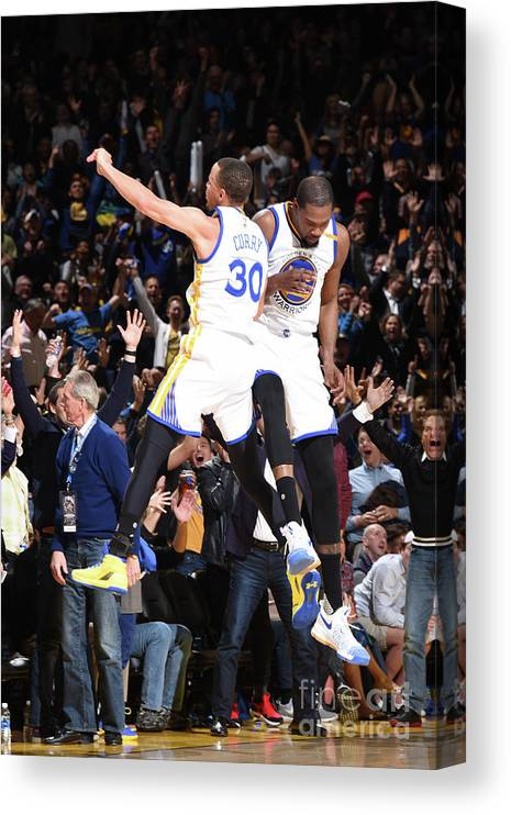 Nba Pro Basketball Canvas Print featuring the photograph Stephen Curry and Kevin Durant by Andrew D. Bernstein