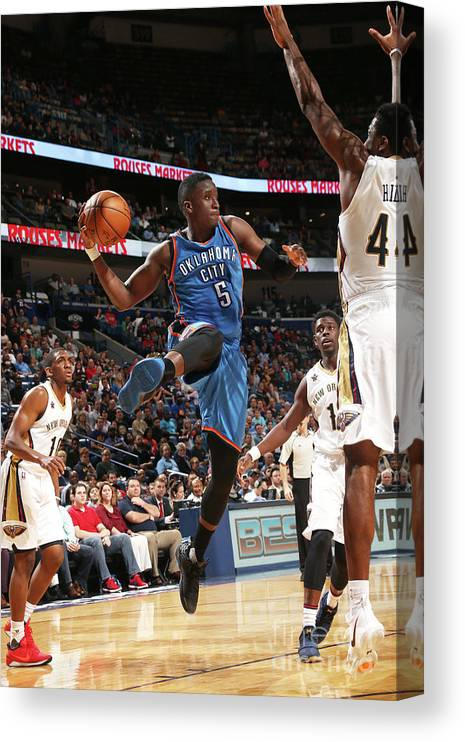 Smoothie King Center Canvas Print featuring the photograph Victor Oladipo by Layne Murdoch