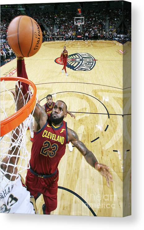 Smoothie King Center Canvas Print featuring the photograph Lebron James by Layne Murdoch
