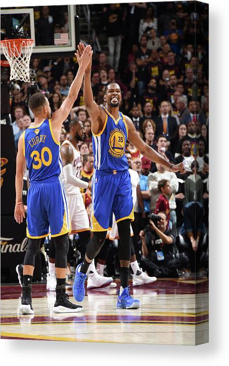 Playoffs Canvas Print featuring the photograph Stephen Curry and Kevin Durant by Andrew D. Bernstein