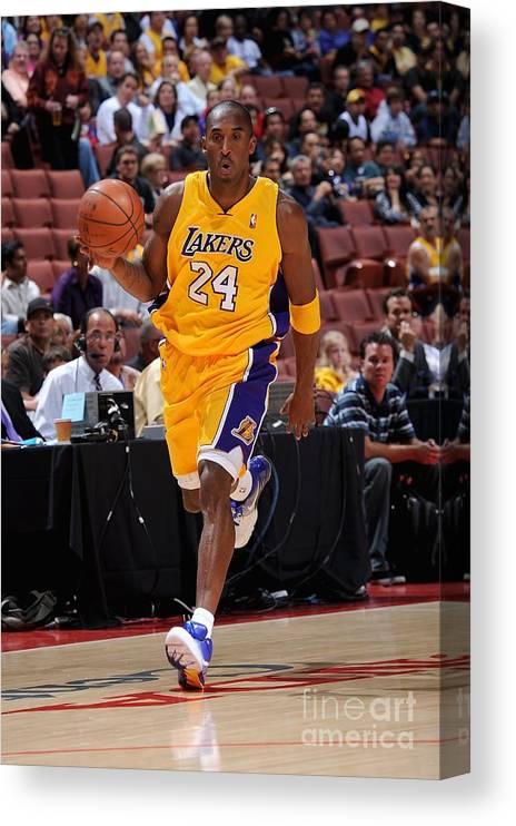 Nba Pro Basketball Canvas Print featuring the photograph Kobe Bryant by Noah Graham