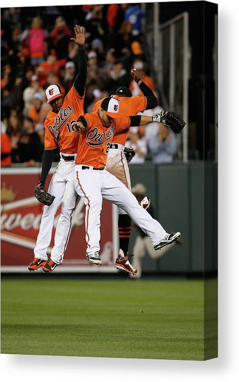 Following Canvas Print featuring the photograph Alejandro De Aza, Steve Pearce, and Adam Jones by Rob Carr