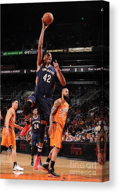 Nba Pro Basketball Canvas Print featuring the photograph Alexis Ajinca by Barry Gossage