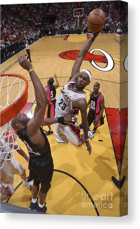 Nba Pro Basketball Canvas Print featuring the photograph Alonzo Mourning and Lebron James by Andrew D. Bernstein