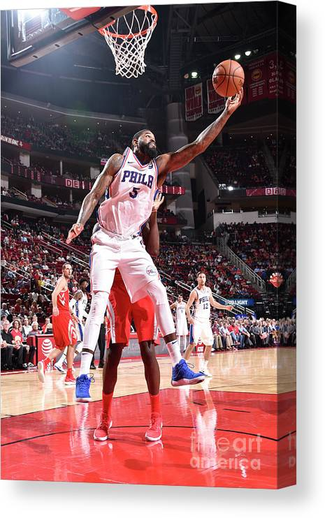 Nba Pro Basketball Canvas Print featuring the photograph Amir Johnson by Bill Baptist