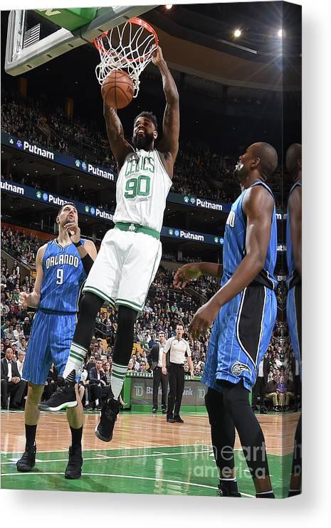 Nba Pro Basketball Canvas Print featuring the photograph Amir Johnson by Steve Babineau