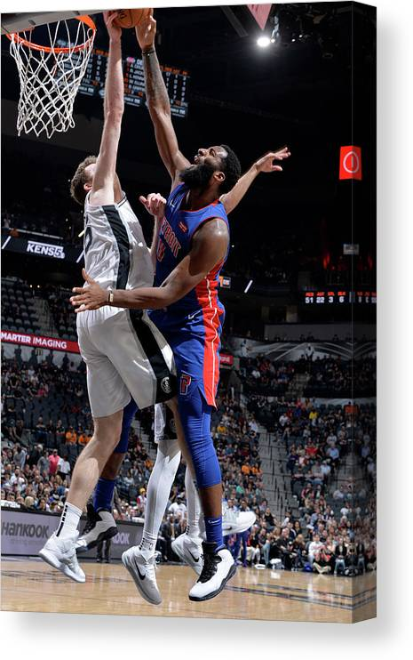Nba Pro Basketball Canvas Print featuring the photograph Andre Drummond and Jakob Poeltl by Mark Sobhani