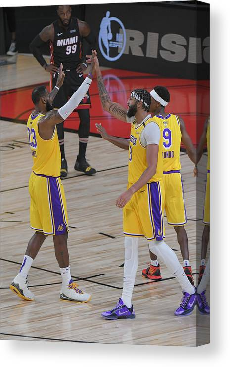 Playoffs Canvas Print featuring the photograph Anthony Davis and Lebron James by Fernando Medina