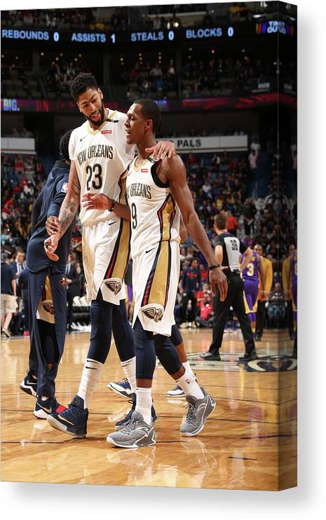 Smoothie King Center Canvas Print featuring the photograph Anthony Davis and Rajon Rondo by Layne Murdoch