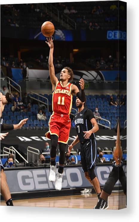 Nba Pro Basketball Canvas Print featuring the photograph Atlanta Hawks v Orlando Magic by Gary Bassing