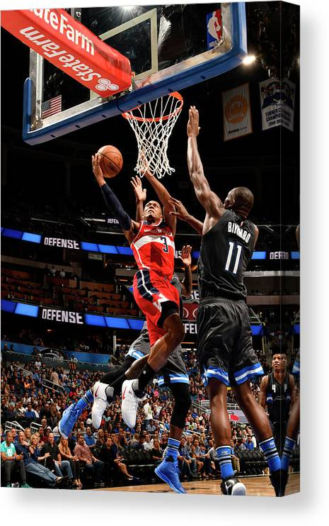 Nba Pro Basketball Canvas Print featuring the photograph Bismack Biyombo and Bradley Beal by Fernando Medina