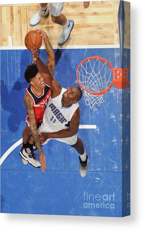 Nba Pro Basketball Canvas Print featuring the photograph Bismack Biyombo and Kelly Oubre by Fernando Medina