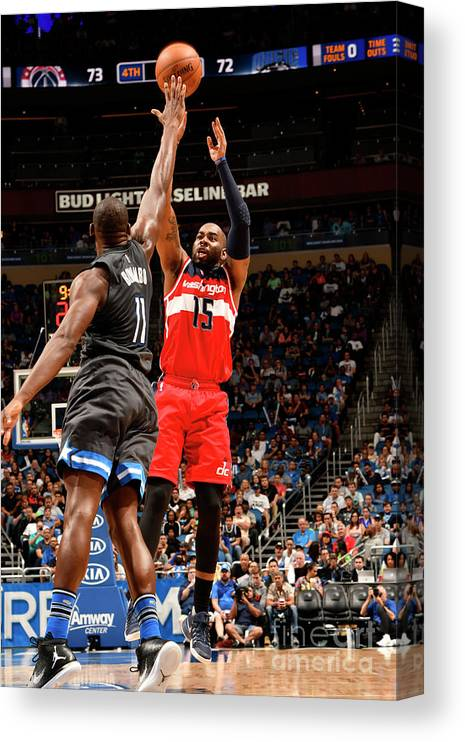 Nba Pro Basketball Canvas Print featuring the photograph Bismack Biyombo and Marcus Thornton by Fernando Medina