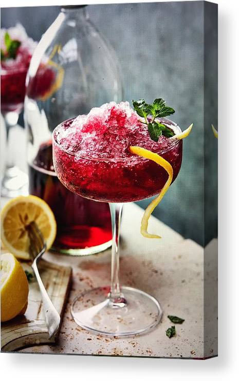 Refreshment Canvas Print featuring the photograph Black currant crushed ice and lemon by Heidi Coppock-Beard