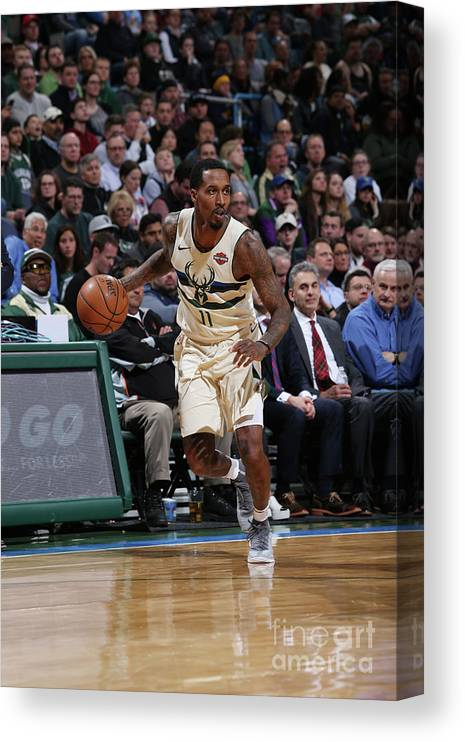 Nba Pro Basketball Canvas Print featuring the photograph Brandon Jennings by Gary Dineen