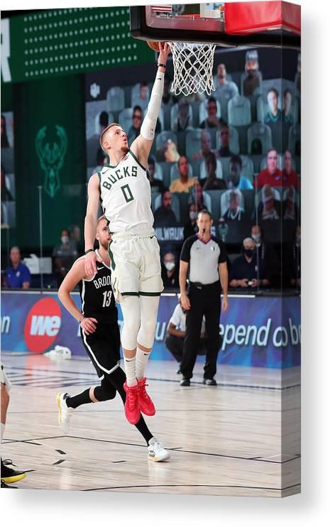 Nba Pro Basketball Canvas Print featuring the photograph Brooklyn Nets v Milwaukee Bucks by Joe Murphy
