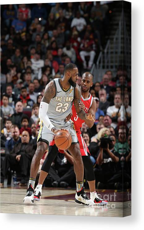 Nba Pro Basketball Canvas Print featuring the photograph Chris Paul and Lebron James by Joe Murphy