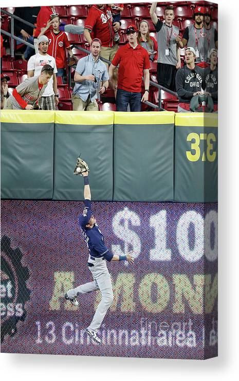 Great American Ball Park Canvas Print featuring the photograph Christian Yelich by Joe Robbins
