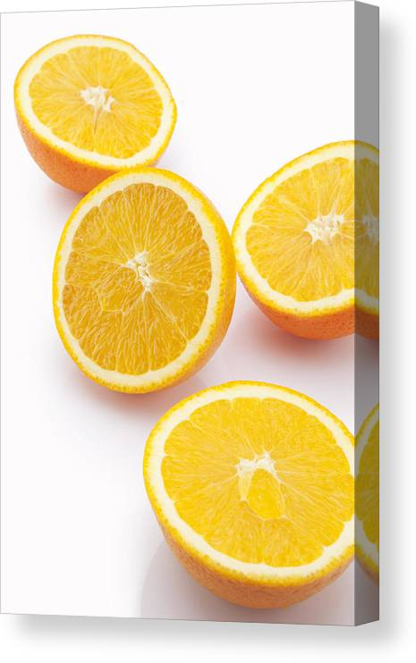 White Background Canvas Print featuring the photograph Close-up of sliced oranges by Ravi Ranjan