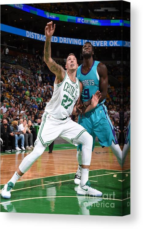 Nba Pro Basketball Canvas Print featuring the photograph Daniel Theis and Mangok Mathiang by Brian Babineau