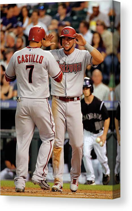 Second Inning Canvas Print featuring the photograph David Peralta, Welington Castillo, and Kyle Kendrick by Doug Pensinger