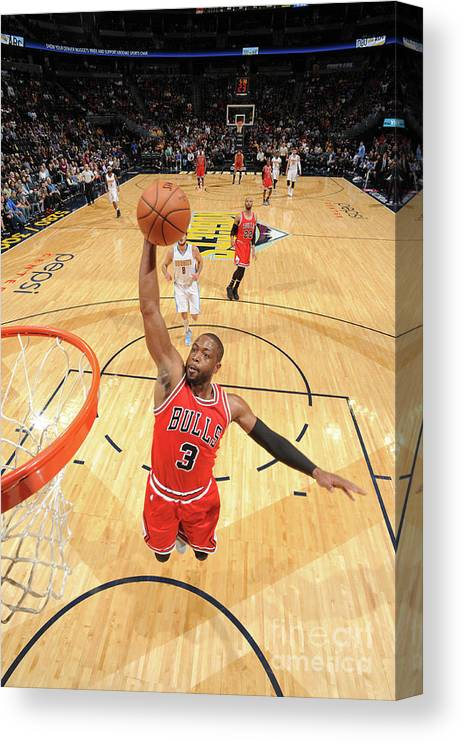 Nba Pro Basketball Canvas Print featuring the photograph Dwyane Wade by Garrett Ellwood