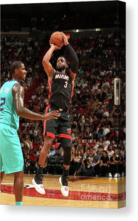 Nba Pro Basketball Canvas Print featuring the photograph Dwyane Wade by Oscar Baldizon