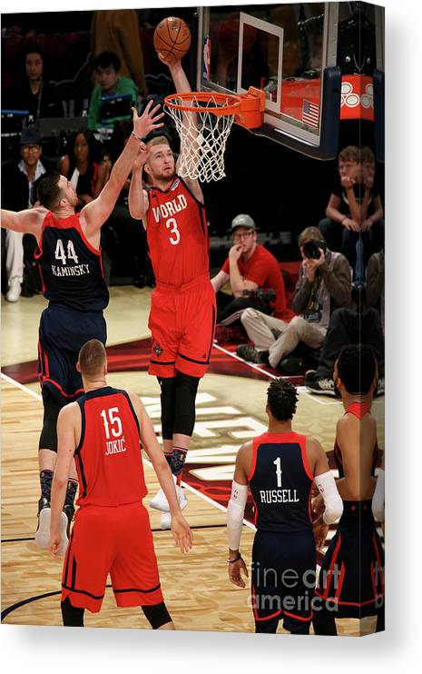 Smoothie King Center Canvas Print featuring the photograph Frank Kaminsky and Domantas Sabonis by Gary Dineen