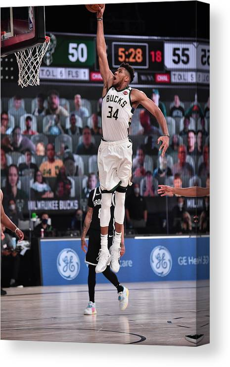 Nba Pro Basketball Canvas Print featuring the photograph Giannis Antetokounmpo by David Dow