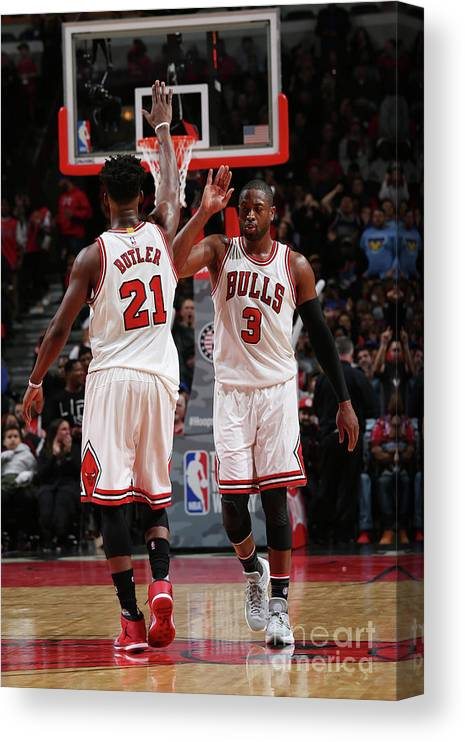 Chicago Bulls Canvas Print featuring the photograph Jimmy Butler and Dwyane Wade by Gary Dineen