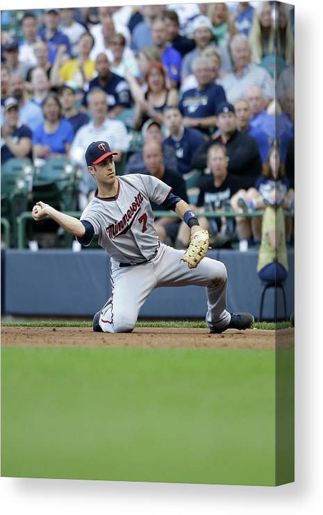Joe Mauer Canvas Print featuring the photograph Joe Mauer and Lyle Overbay by Mike Mcginnis