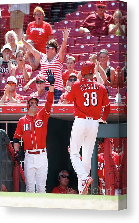 Great American Ball Park Canvas Print featuring the photograph Joey Votto and Wade Davis by Joe Robbins