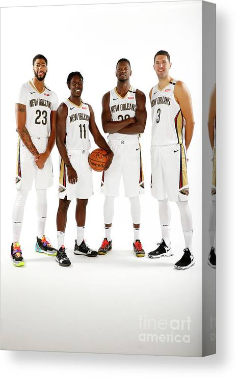 Media Day Canvas Print featuring the photograph Jrue Holiday, Anthony Davis, and Julius Randle by Jonathan Bachman