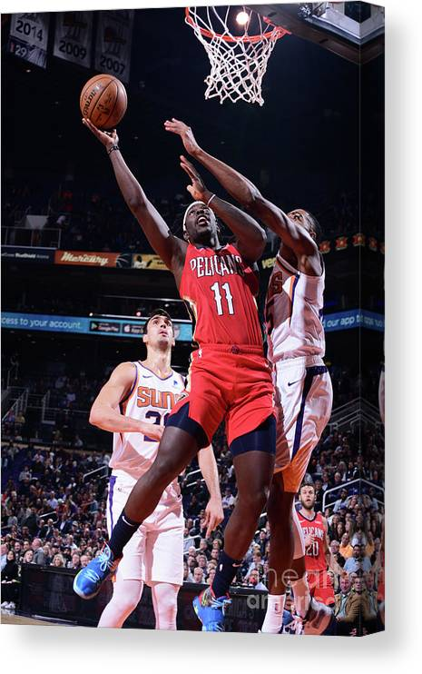 Nba Pro Basketball Canvas Print featuring the photograph Jrue Holiday by Michael Gonzales