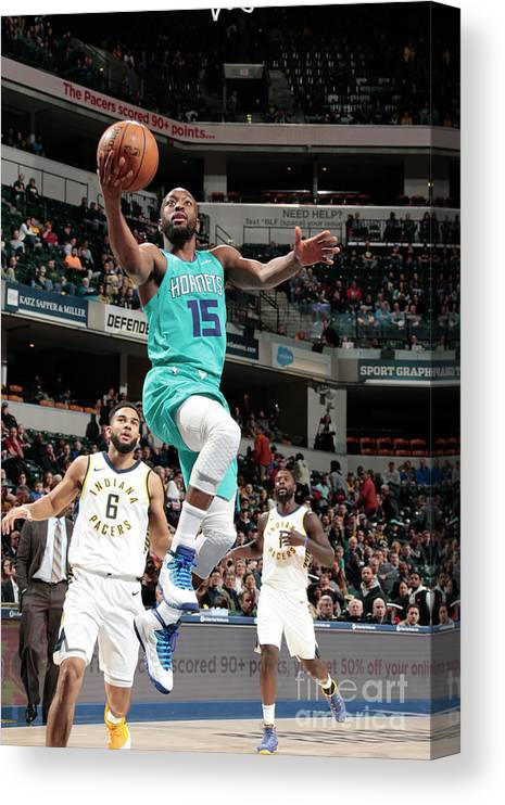Kemba Walker Canvas Print featuring the photograph Kemba Walker by Ron Hoskins