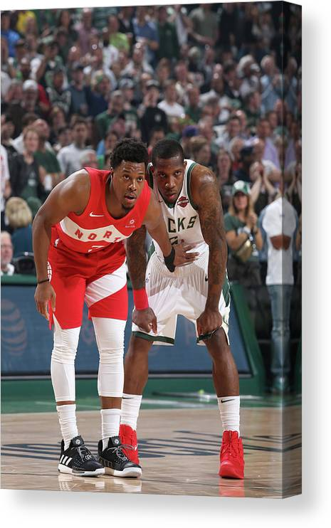 Nba Pro Basketball Canvas Print featuring the photograph Kyle Lowry and Eric Bledsoe by Gary Dineen