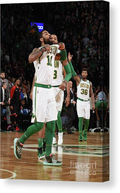 Nba Pro Basketball Canvas Print featuring the photograph Kyrie Irving and Marcus Morris by Brian Babineau