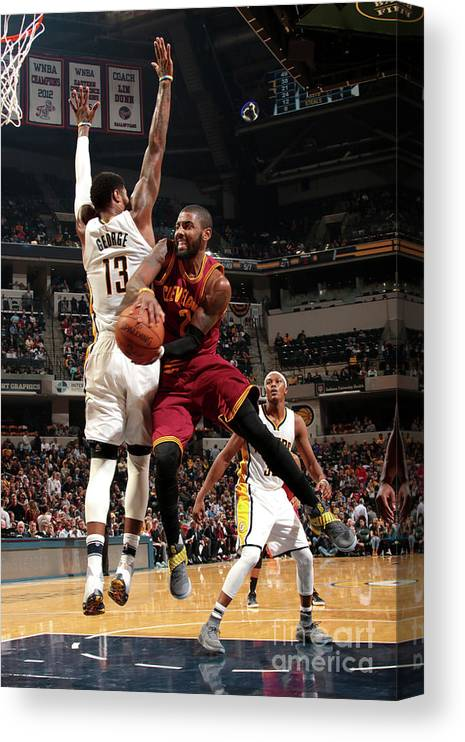 Nba Pro Basketball Canvas Print featuring the photograph Kyrie Irving by Ron Hoskins
