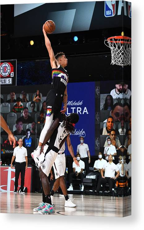 Nba Pro Basketball Canvas Print featuring the photograph LA Clippers v Denver Nuggets - Game Three by Garrett Ellwood