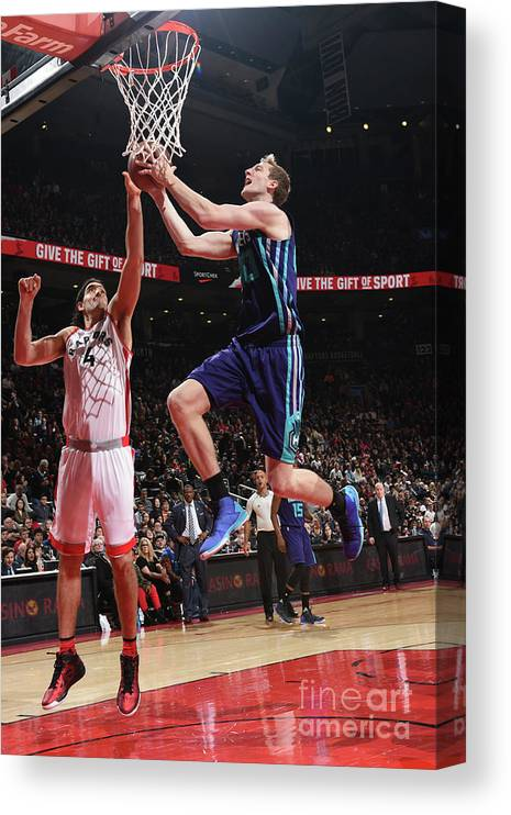 Nba Pro Basketball Canvas Print featuring the photograph Luis Scola and Cody Zeller by Ron Turenne