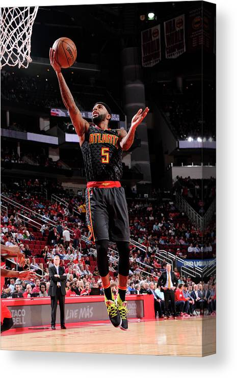 Nba Pro Basketball Canvas Print featuring the photograph Malcolm Delaney by Bill Baptist