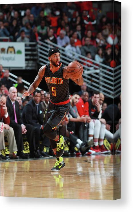 Nba Pro Basketball Canvas Print featuring the photograph Malcolm Delaney by Jeff Haynes