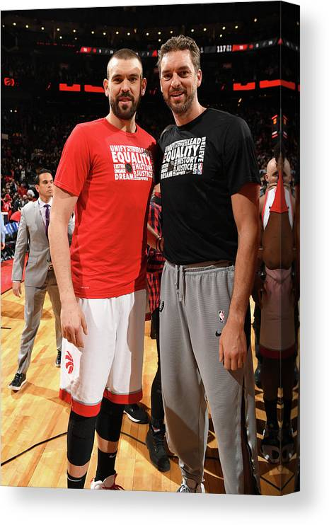 Nba Pro Basketball Canvas Print featuring the photograph Marc Gasol and Pau Gasol by Ron Turenne